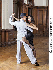 Confident Woman Performing With Male Tango Dancer