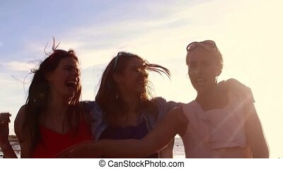 group of happy women or girls dancing on beach 44 - summer...