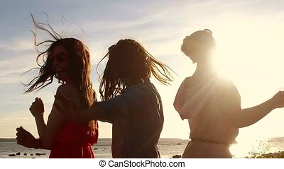 group of happy women or girls dancing on beach 37 - summer...