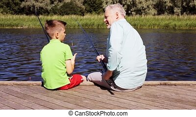 grandfather and grandson fishing on river berth 21 - family,...