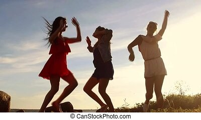 group of happy women or girls dancing on beach 54 - summer...