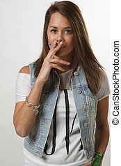 Young woman smoking - teenage girl smoking a cigarette