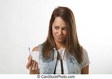 I don't like this cigarette - twenty something girl holding...