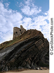 castle tower on a high layered cliff