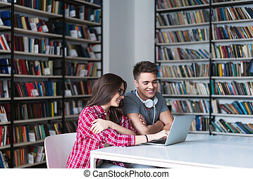 Studens with laptop - Young people in a library