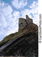 castle ruin on a high layered cliff