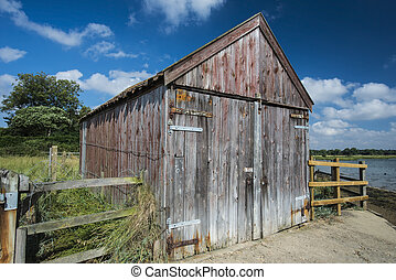 Old Wooden Boathouse - Old wooden boathouse on the edge of a...
