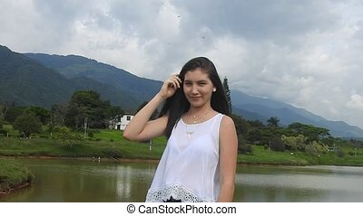 Happy Teen Girl In Countryside Near Mountains