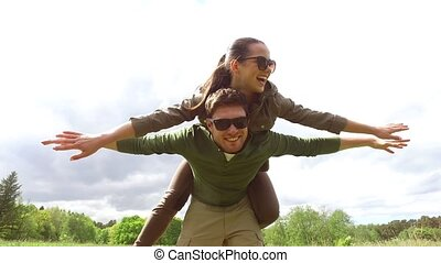 happy couple having fun outdoors - leisure, love, free time...