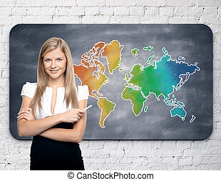 Travel concept - Businesswoman standing against chalkboard...