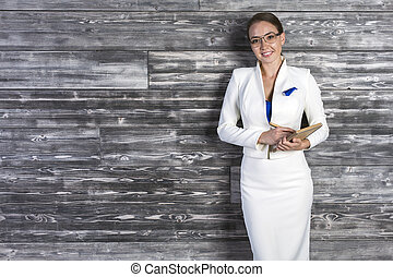 Happy businesswoman with notepad - Beautiful cheerful woman...
