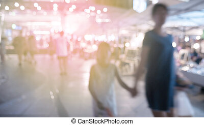 Blurred image of people shopping at night market use for...