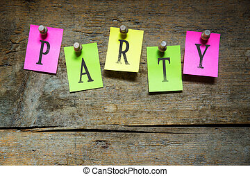 Pinned sticky notes with the word party on wooden wall