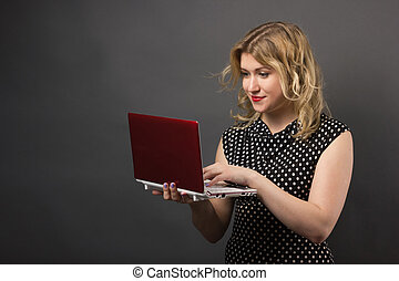 Student woman in glasses with tablet pc studying