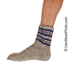 Knitted warm sock - Leg of caucasian man in knitted warm...