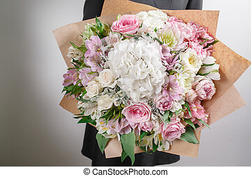 Florist at work. Make hydrangea rich bouquet. Vintage...