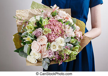 Florist at work. Make hydrangea rich bouquet. Vintage...