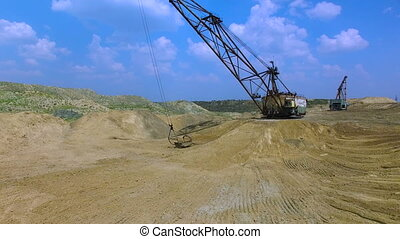 Flying in the career of an excavator - Flying over the...