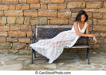 Woman relaxing in lace nightgown - Stunning young woman...