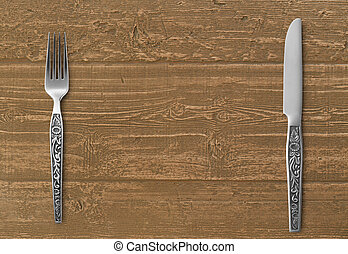 Table knife and fork on wood table