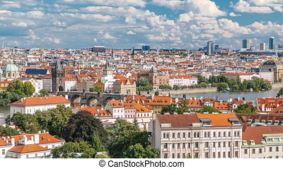 Panorama of Prague Old Town with red roofs timelapse, famous Charles bridge and Vltava river, Czech Republic.