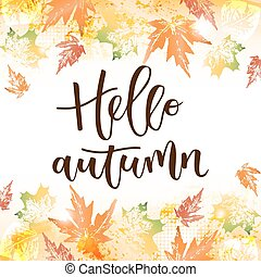 Hello autumn hand written inscription on fall leaves...