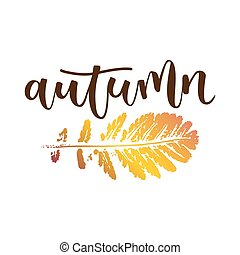 Autumn hand written inscription with yellow brown leaf on...