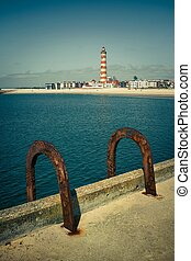 Rusty Handrails - Pier with a pair of rusty handrails of a...