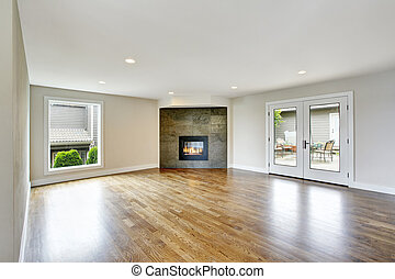 Empty living room interior in light tones with fireplace.