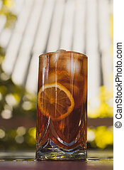 Soft drink with ice and lemon on wooden table, soft drinks...