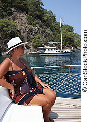 On vacation - An english lady relaxing while on a boat trip...
