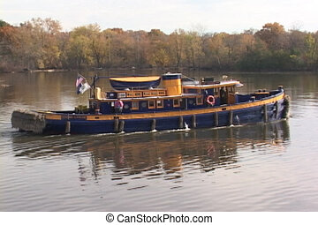 Tugboat on the Erie Canal - A heavy tugboat on New York's...