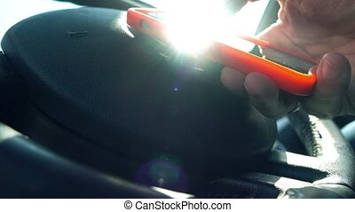Man tapping on a touchscreen of a smartphone in the car. 4K...