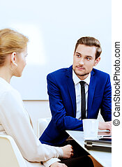 everyday work - Business partners lead the discussion at the...