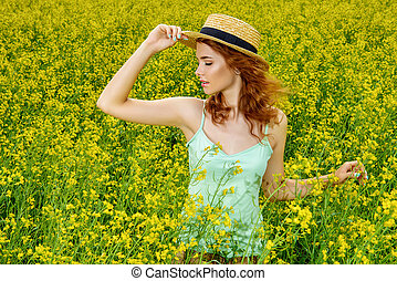 foxy hair belle - Romantic girl standing on a yellow meadow...