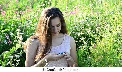 15year girl reads sms on phone - Cute girl talking on the...
