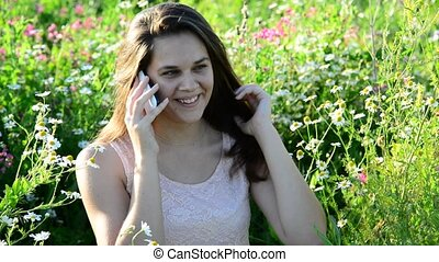 girl talking on phone in park - Cute girl talking on the...