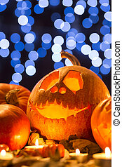 Trick or treat? - Shot of a Halloween pumpkin with a carved...