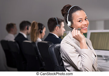 Call center agent - Smiling female call center agent with...
