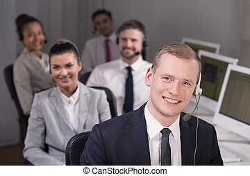 Call centre team - Smiling call centre representatives with...