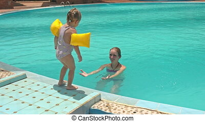 Little Girl Jumps into Mother Arms in Pool at Hotel