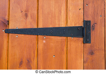 Hinge - Metal hinge on a wooden door