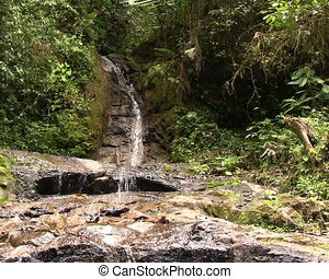 Water trickling over a boulder - At the edge of Rio...