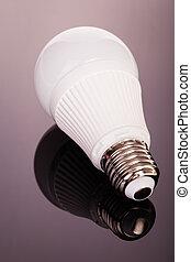 Led lightbulb on glass - a white satinated lightbulb shot...