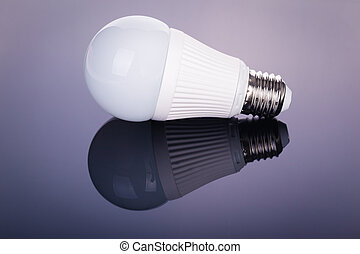 Led lightbulb reflection - a white satinated lightbulb shot...