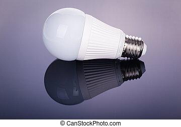 Led lightbulb reflection - a white satinated lightbulb shot...