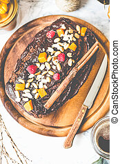 chocolate cake with pumpkin, nuts and frosting, tinting
