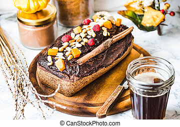 chocolate cake with pumpkin, nuts and frosting, autumn baked