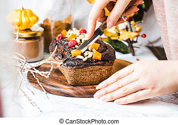 chocolate cake with pumpkin, nuts and frosting