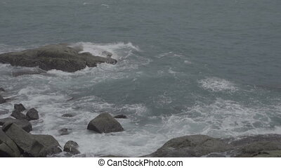 Powerful sea waves crashing on the rocks